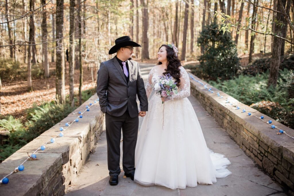bridal seating long sleeve ballgown wedding dress and groom in forest venue