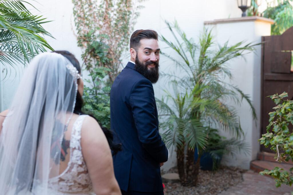 groom looking at bride wearing veil tempe arizona