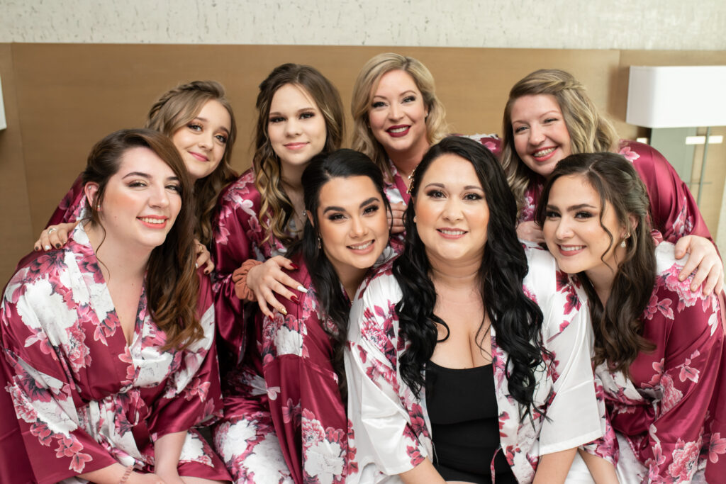 bride and bridesmaids wearing matching floral robes