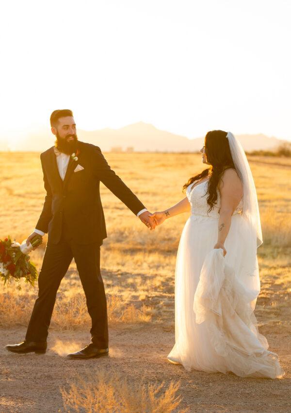 bride and groom walking outside at dusk