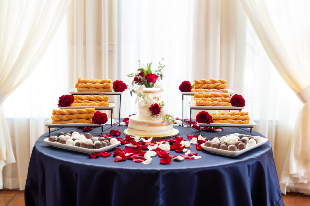 dessert table with churros and rose petals