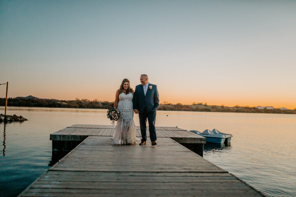 bride and groom on dock hidden lake arizona