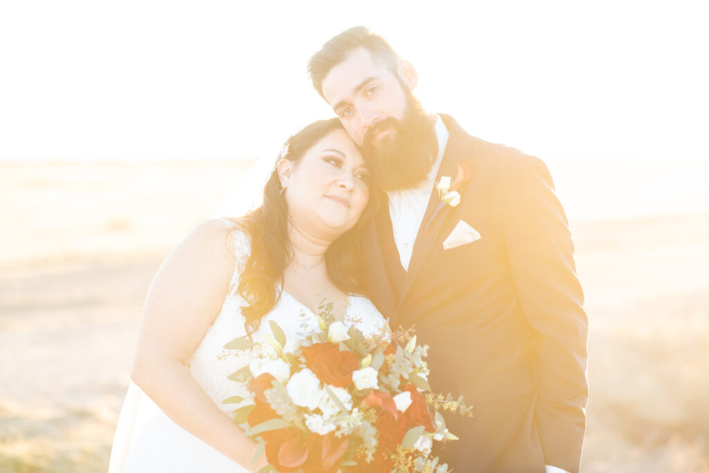 bride and groom with hazy sunset