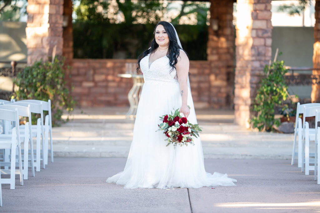 plus size bride in lace and tulle aline wedding dress