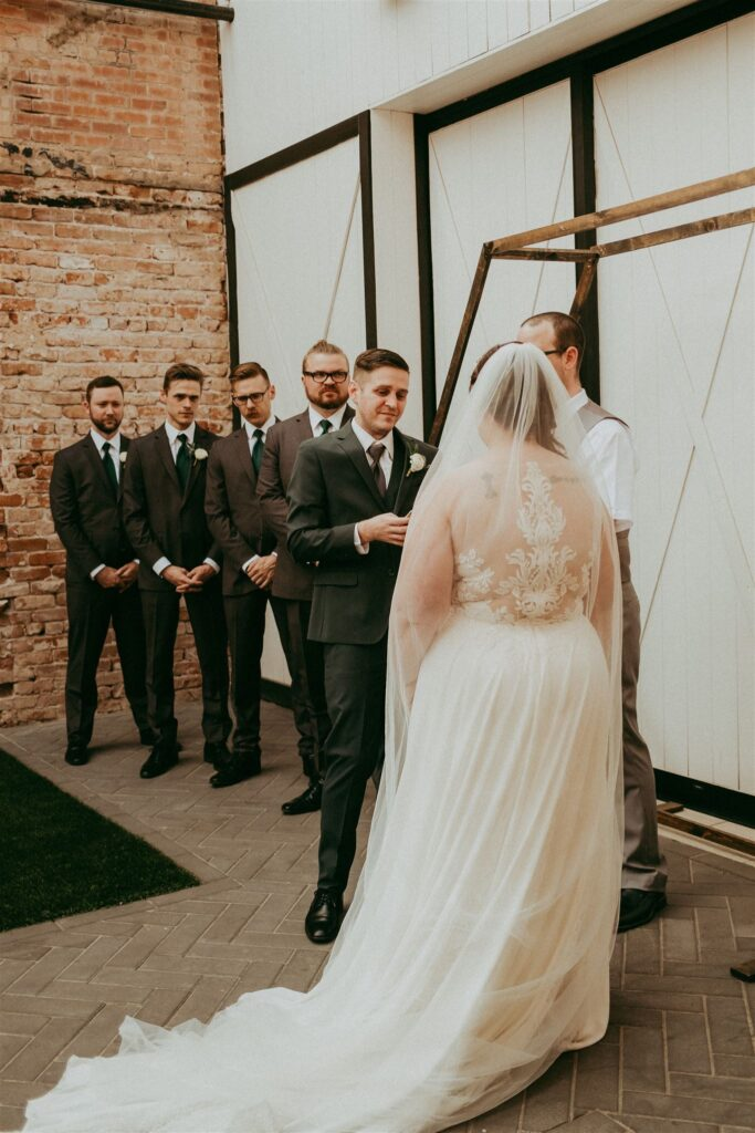 unique back plus size chiffon wedding dress with groomsmen