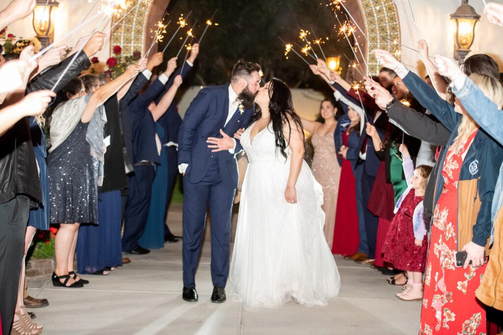 newlyweds kissing under sparkler exit