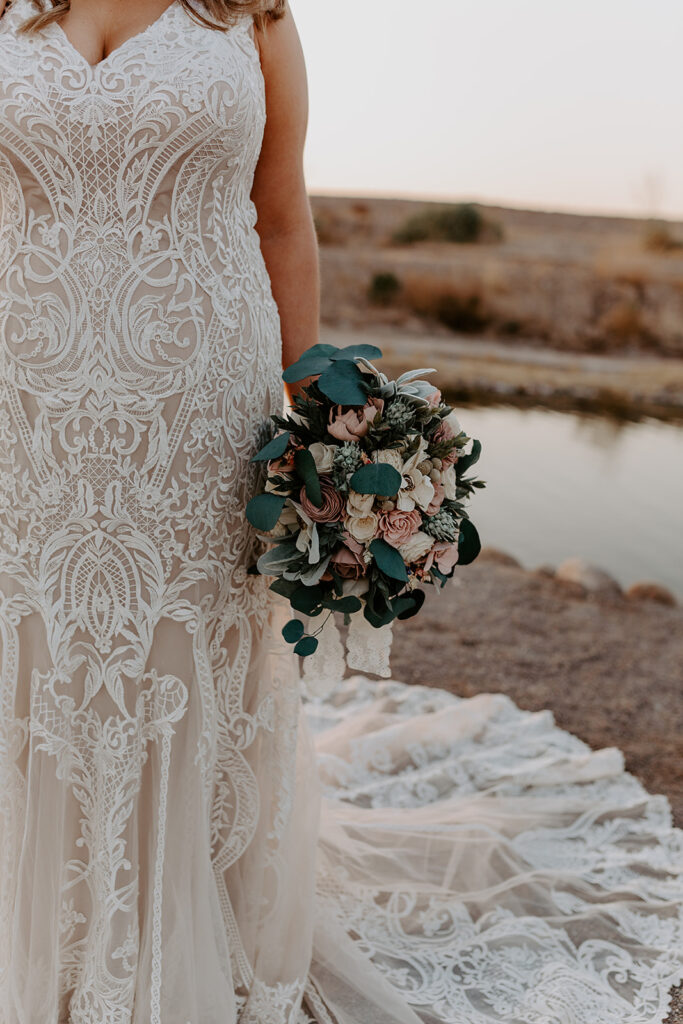 bride wearing lace wedding gown with bouquet