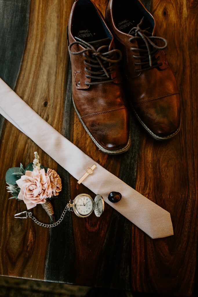 wedding photo of grooms shoes and tie