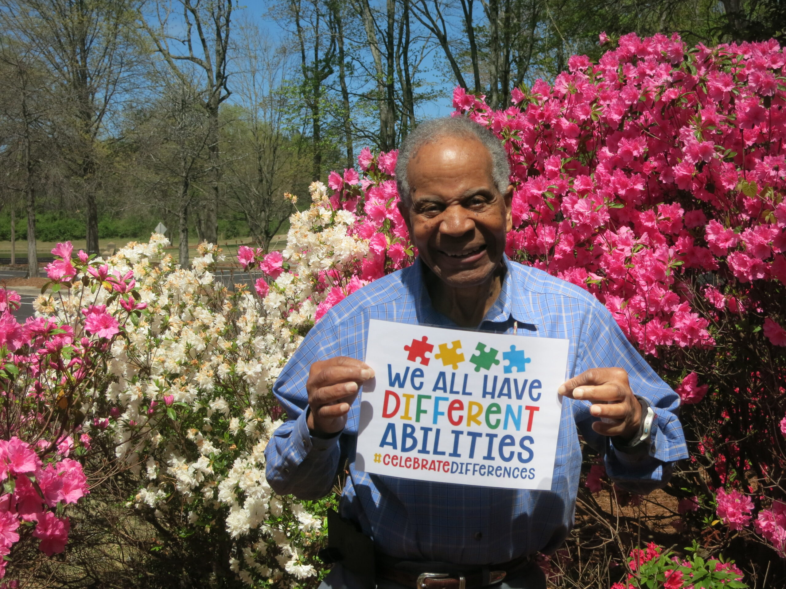 Tec-Masters' CEO Marvin Carroll holding a sign of encouragement for our Autism walk.