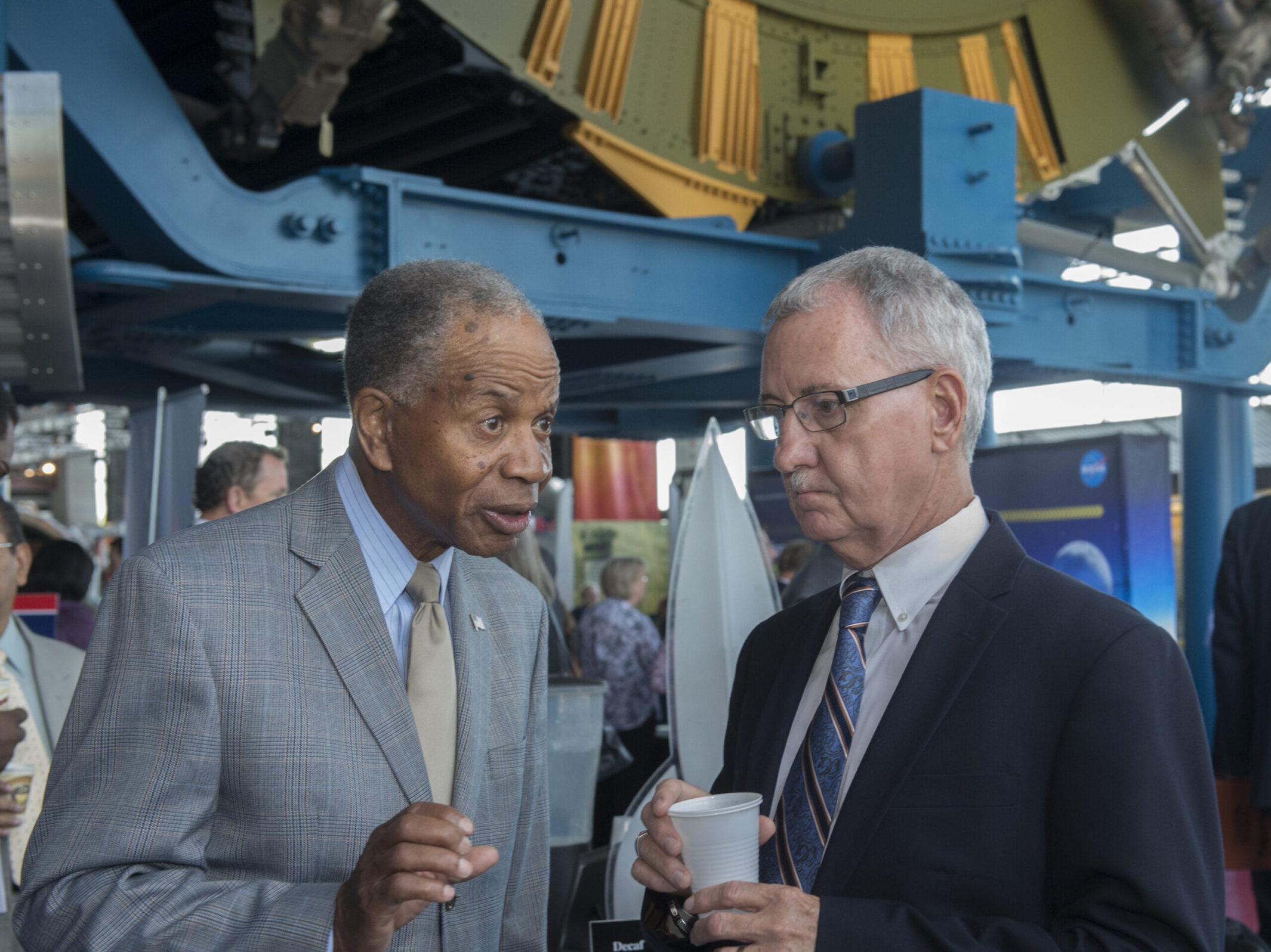 Dr. Marvin Carroll, left, president of Tec-Masters Inc. of Huntsville, speaks with David Brock, small business specialist at Marshall.