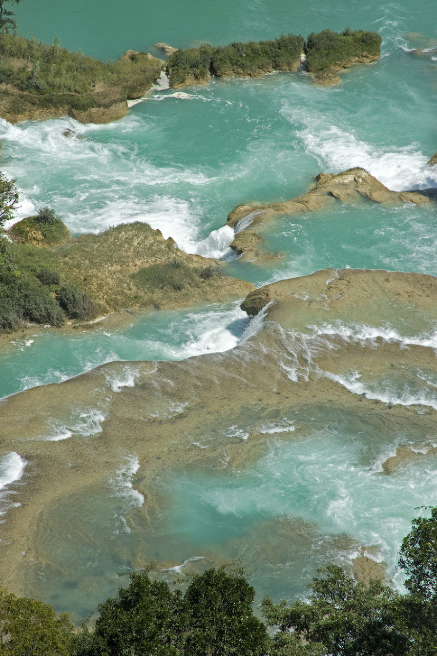 A vertical crop of Rio Santo Domingo at Las Nubes with a 24-120mm lens set at 120mm