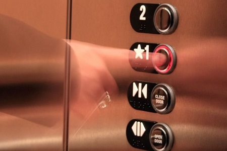 2388425 - business woman pressing elevator button
