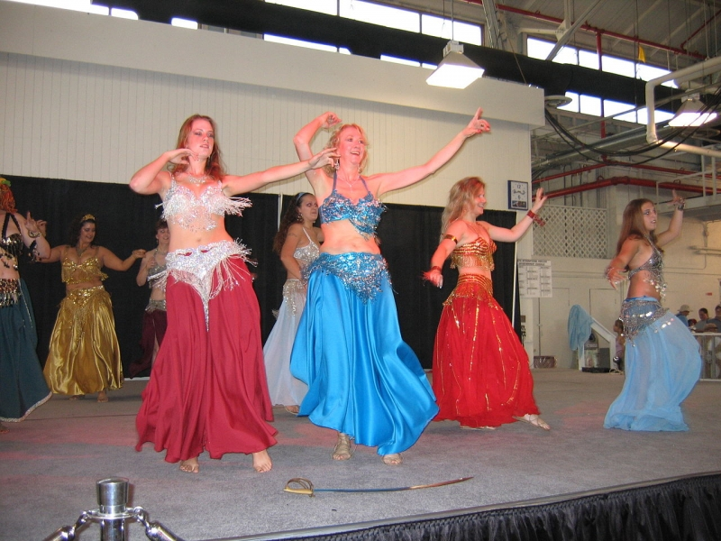 Women learning to belly dance.