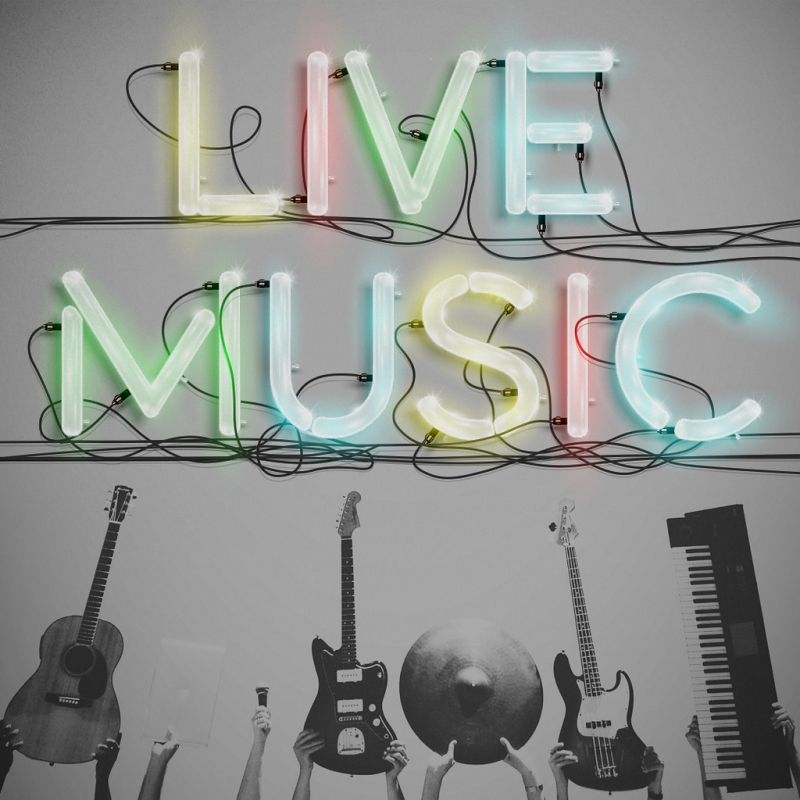 """The words """"Live Music"""" in neon lights above a display of guitars, cymbals and a vertical standing keyboard"""