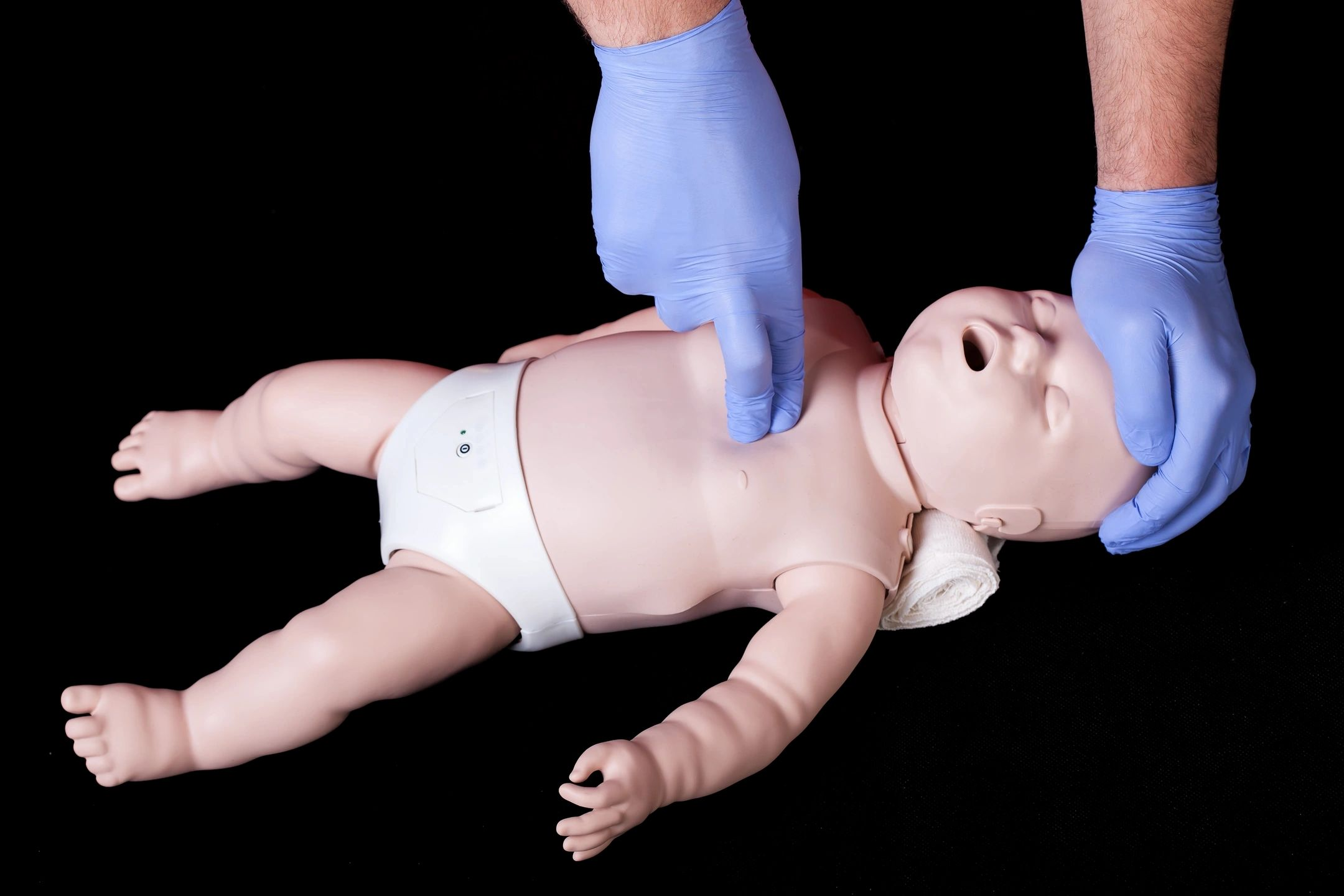 CPR Compressions on a baby dummy