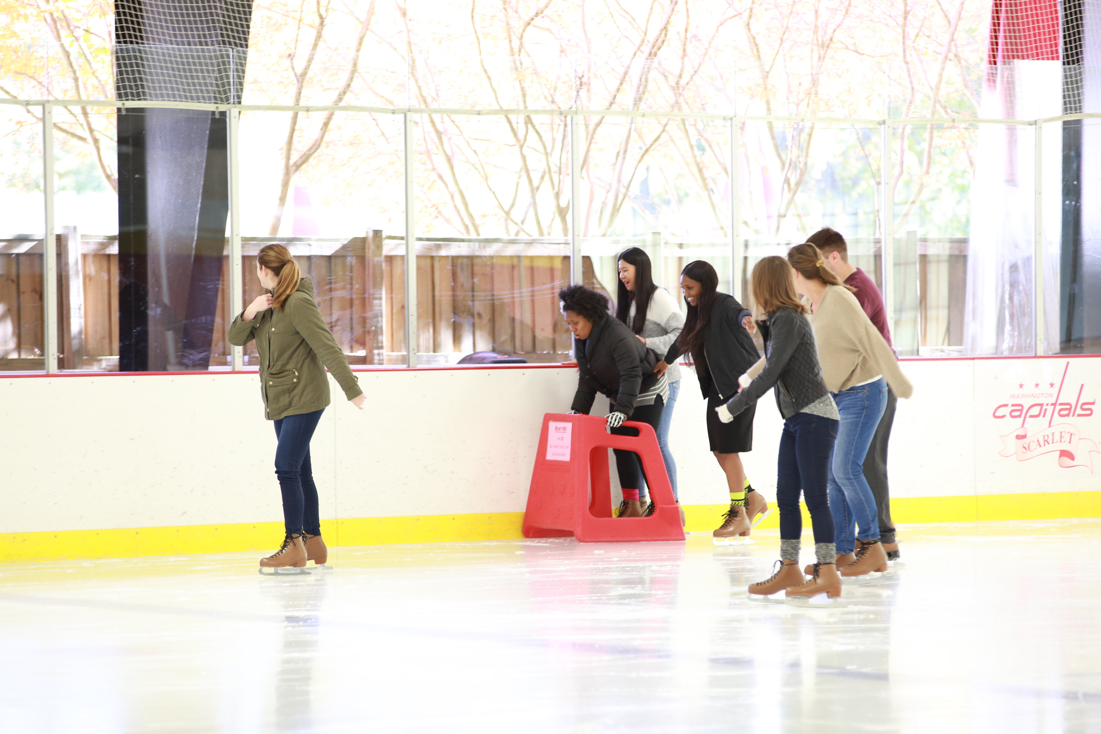 Employees enjoying ice skating day