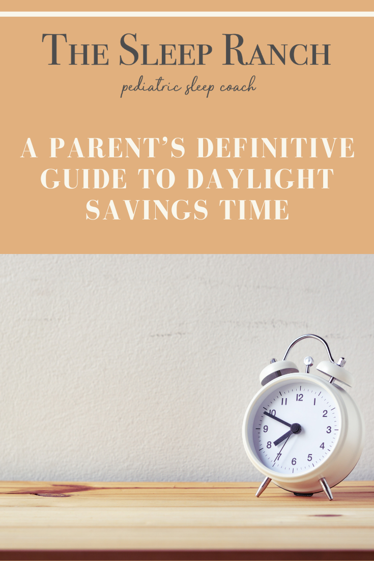 "An analog clock sitting on a wooden table with the text ""A Parents Definitive Guide to Daylight Savings Time"" in white text above it."