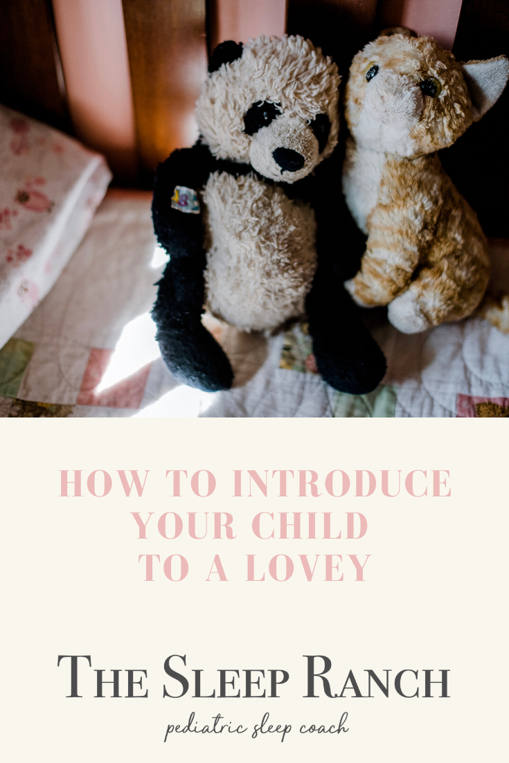 "two worn loveys on a bed with text ""how to introduce your child to a lovey"""