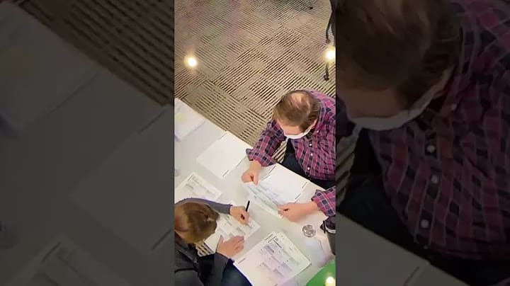 Woman filling in Blank Ballots - Election Fraud