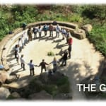 Photo of people in a circle still from the film The Grove