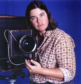 "Photo of a brown haired light skinned person next to a 16x20"" camera"