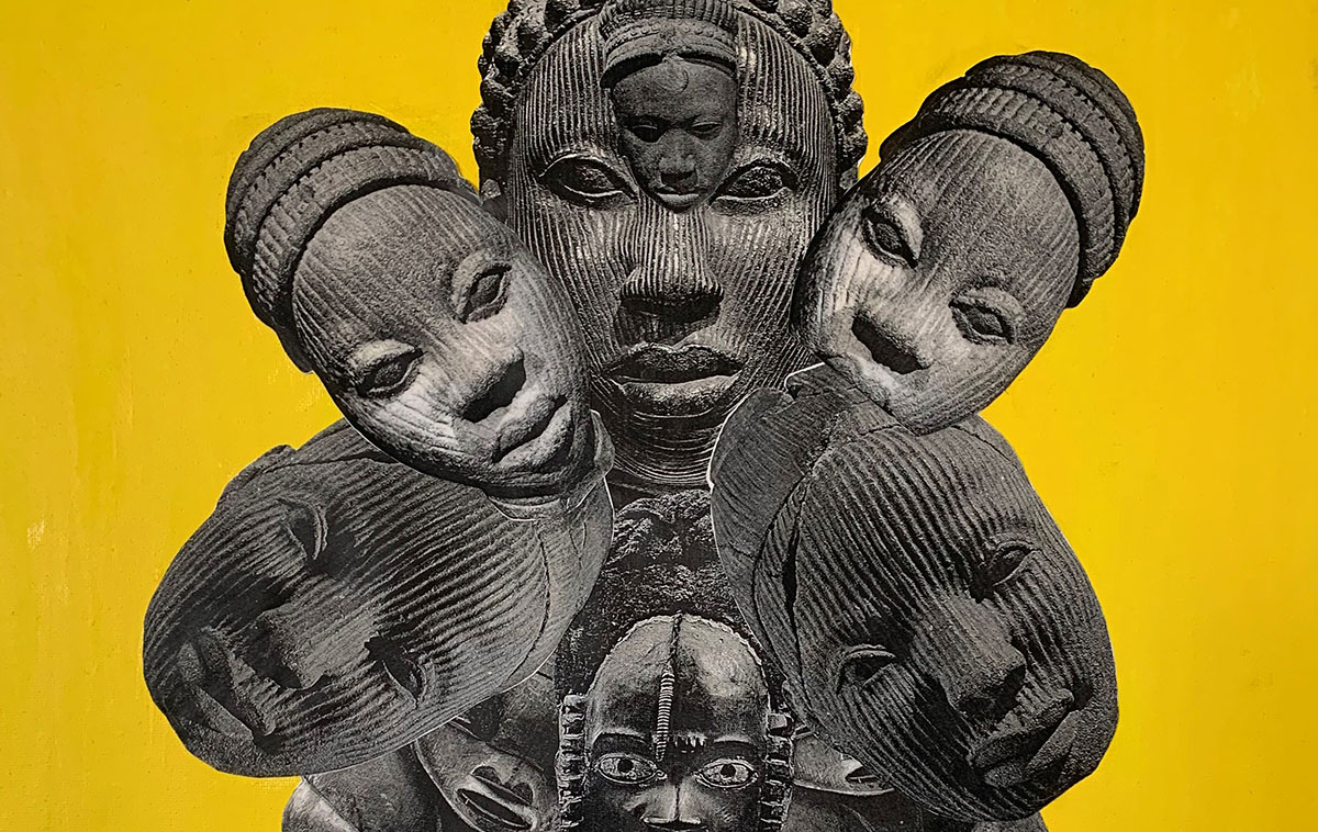 Sculpture of faces on yellow background