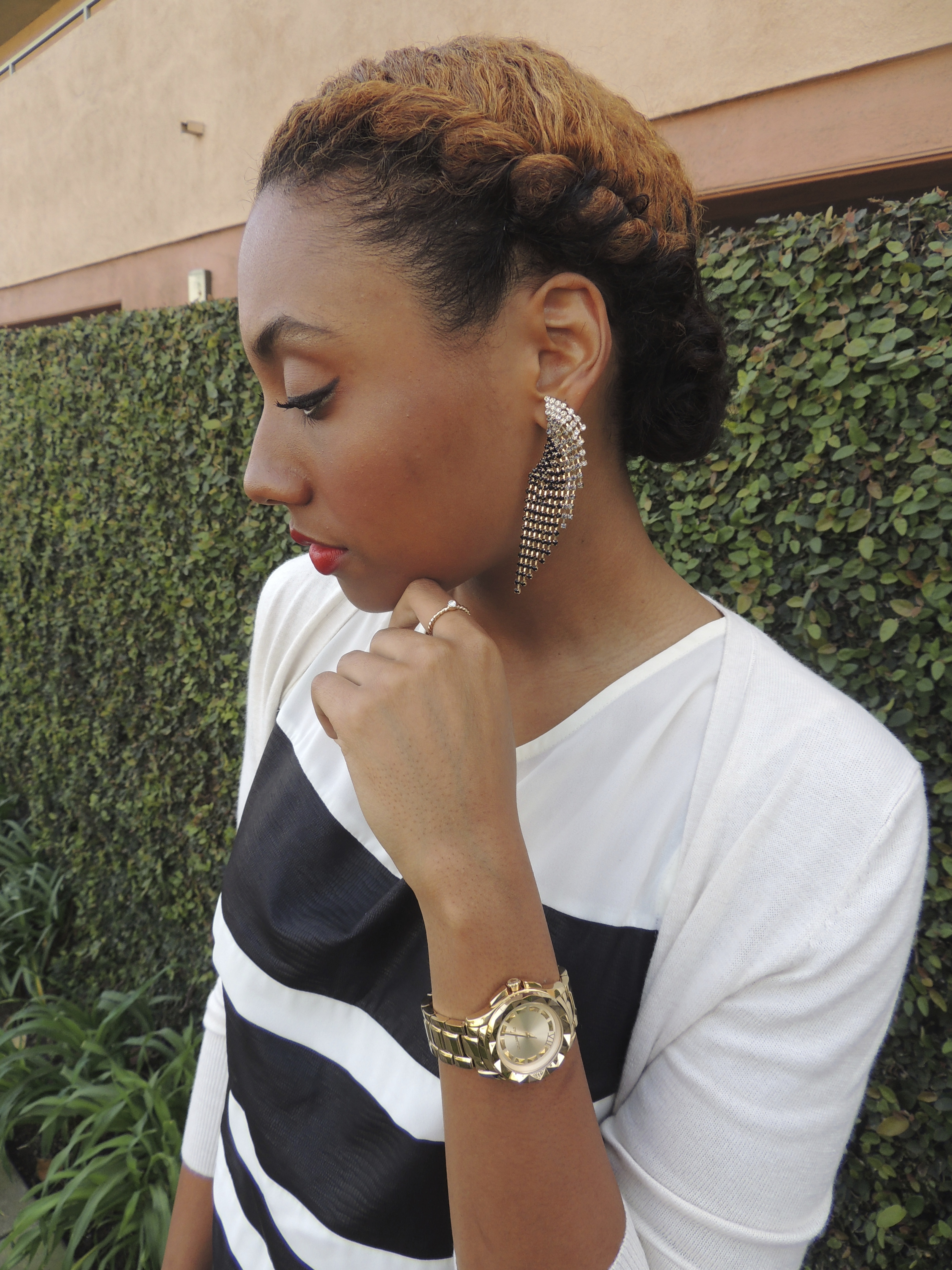 statements earrings and gold watch