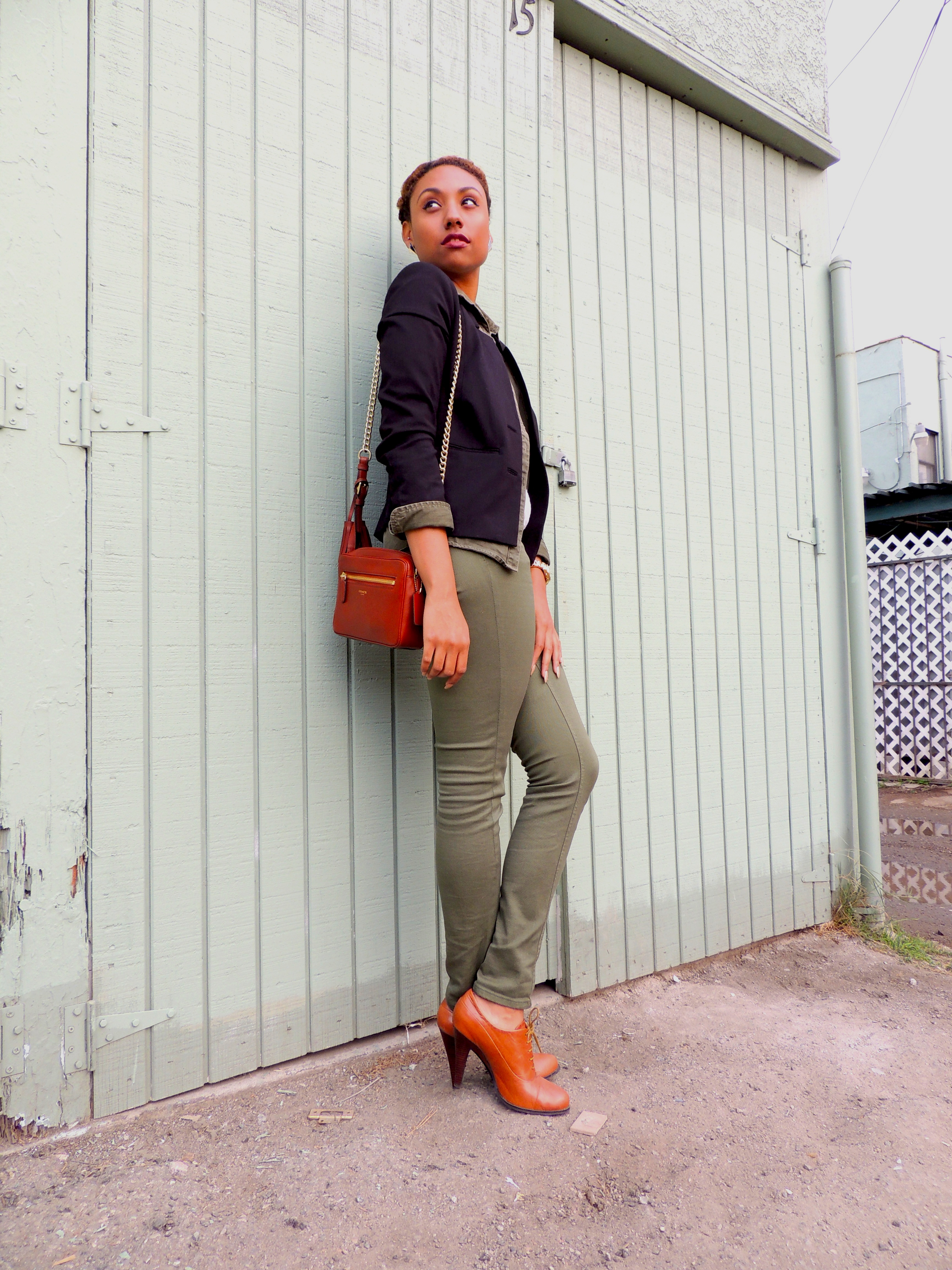 army green outfit with coach bag