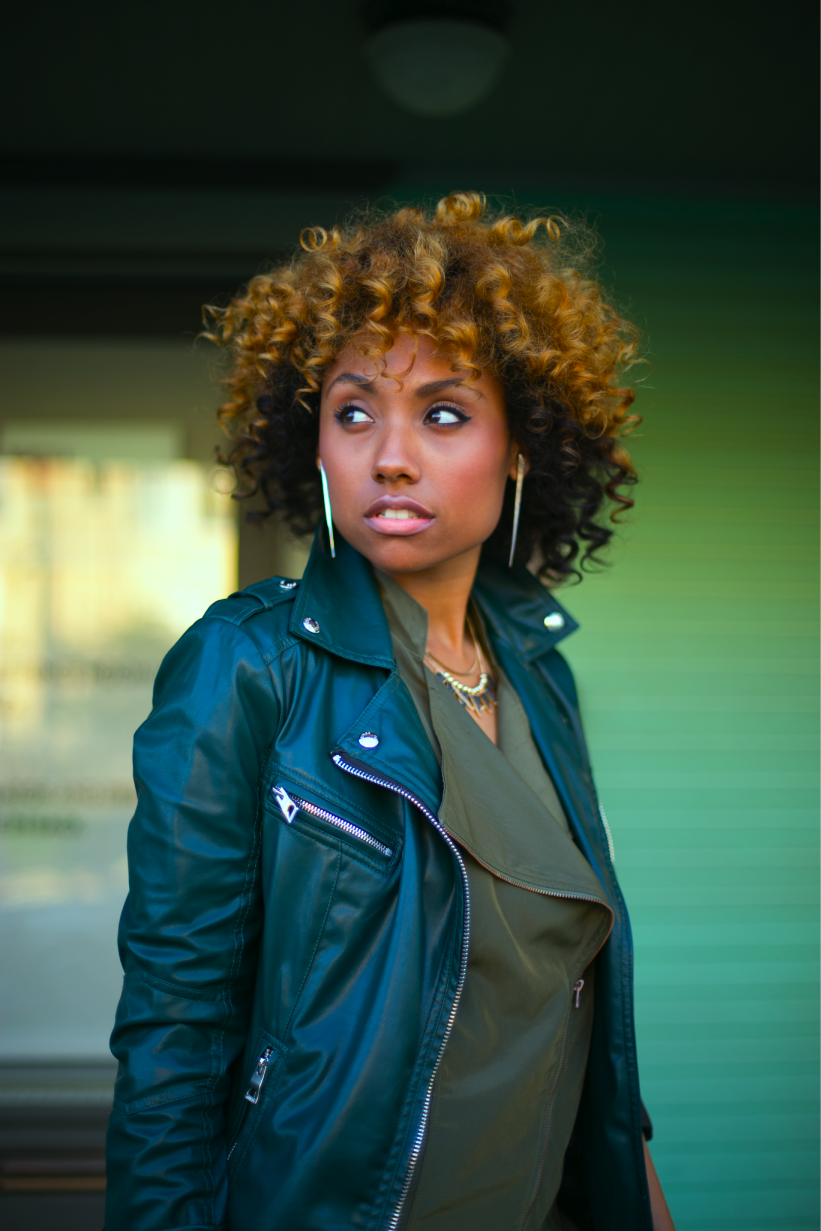 natural hair woman in green outfit