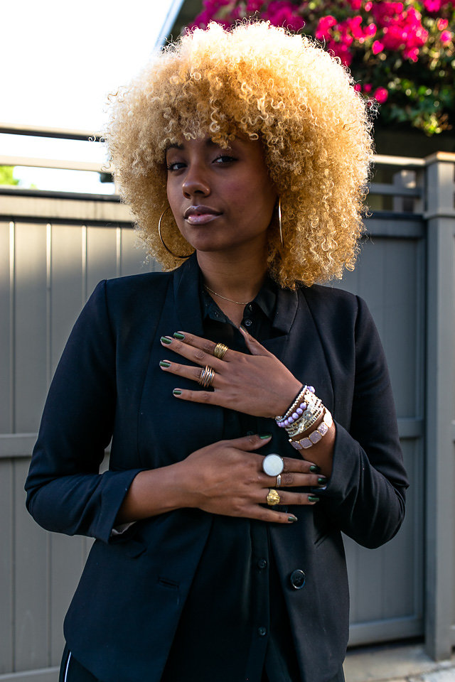 blonde afro-black-blazer-jewelry