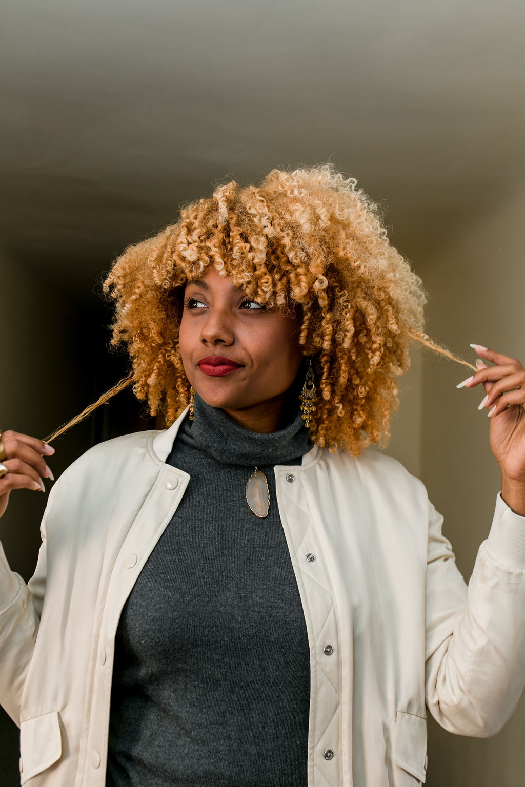 woman with blonde curly hair