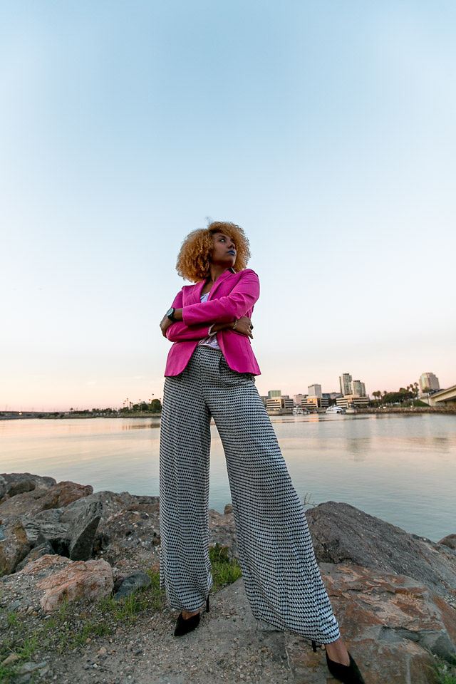 woman wearing wide leg pants and pink blazer