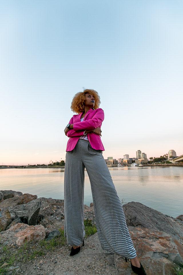 woman wearing wide leg pants and pink blazer