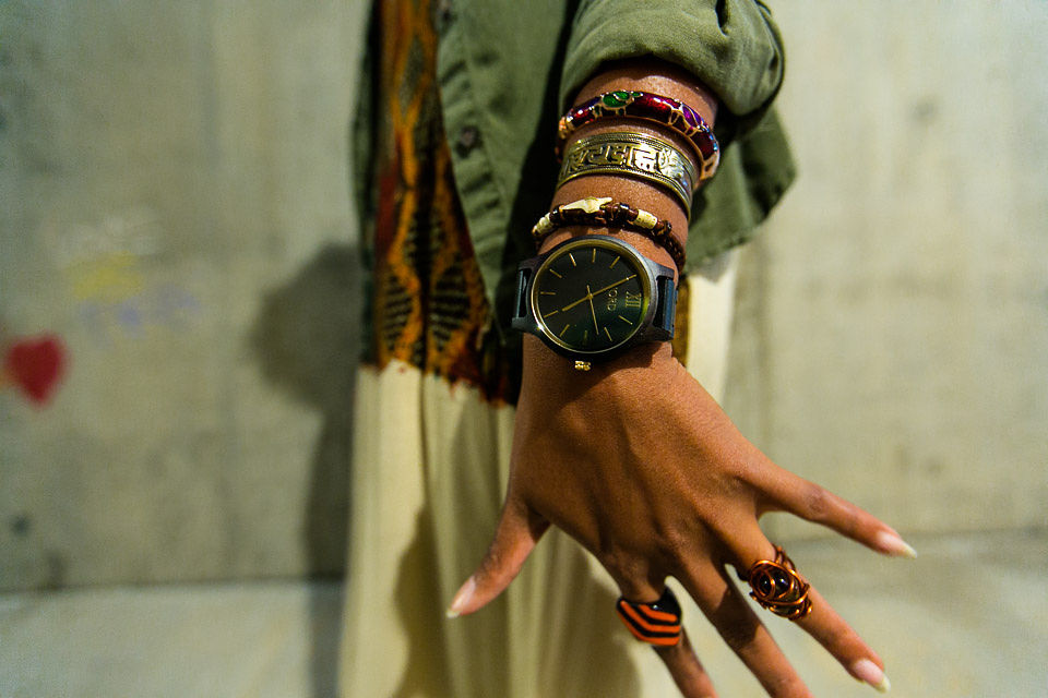 girl with wood watch and jewelry on wrist