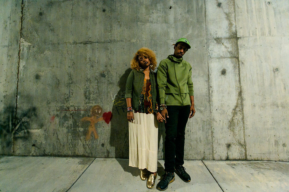 stylish black couple holding hands