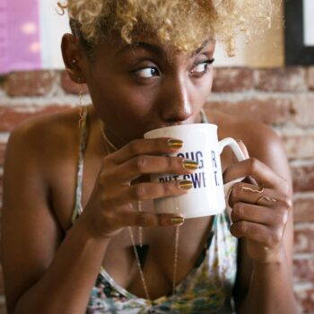 girl sipping coffee-creole amour-wear who you are-lcm