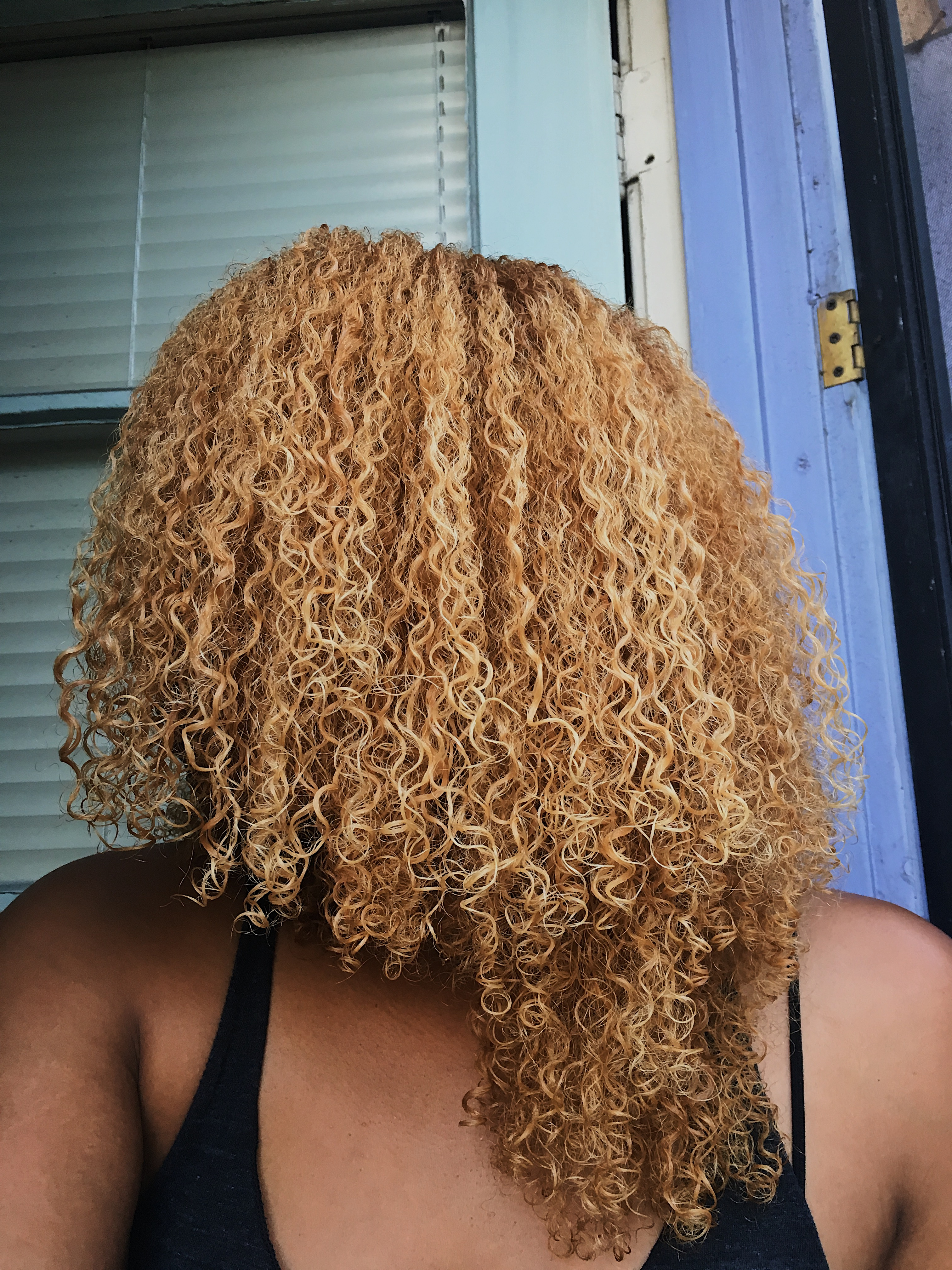 leave in conditioner-wet natural curls-blonde curls
