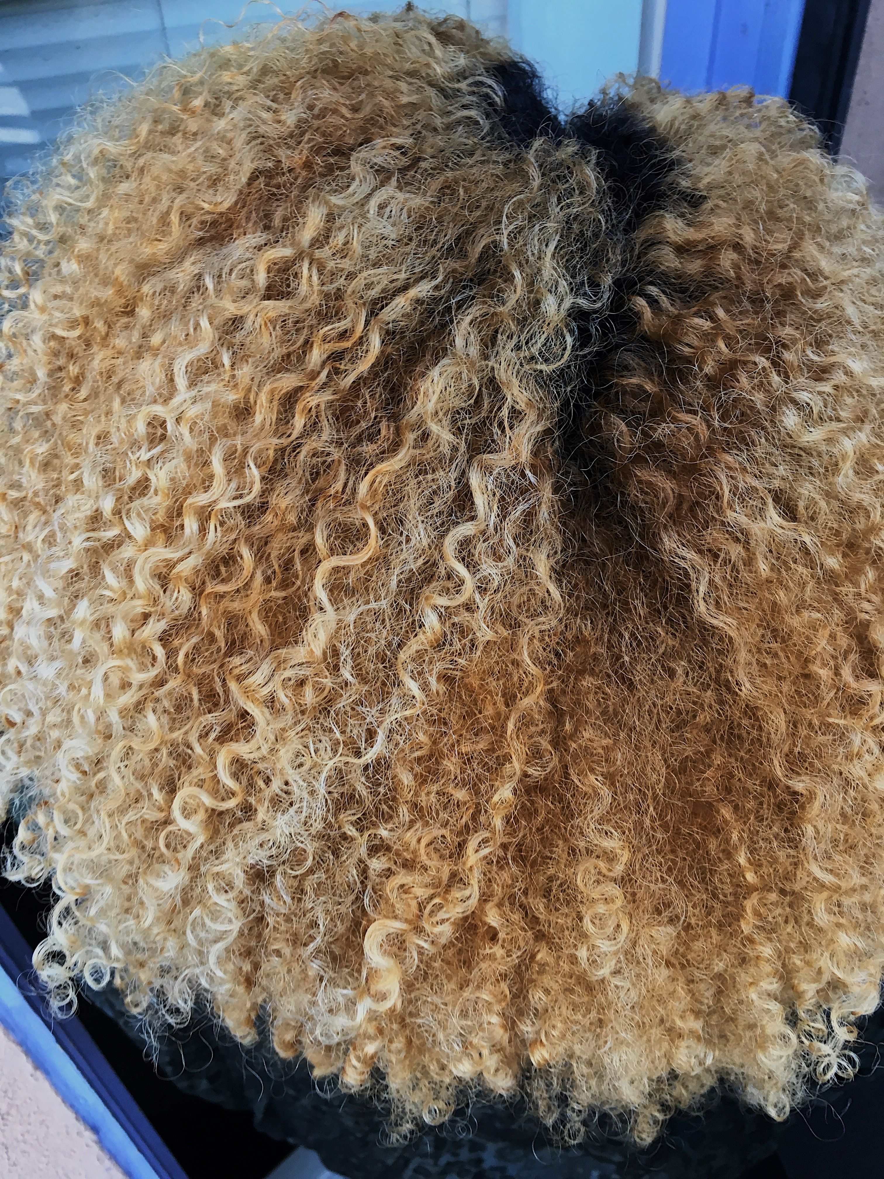 natural hair after using castor oil-blonde curls