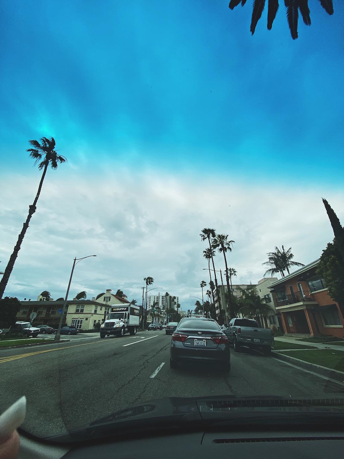 long beach-driving in car-windshield-gods grace