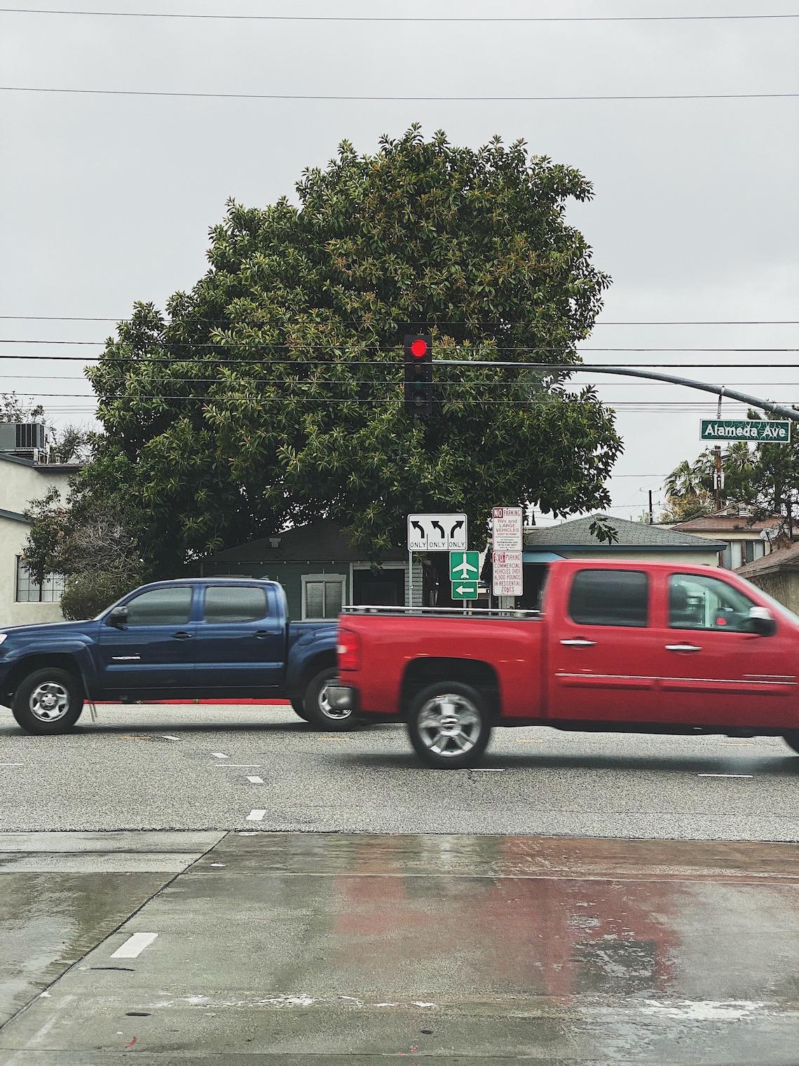 red light-road-rain-trucks-driving-gods grace