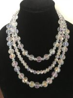 Triple Strand Faceted AB Crystal Necklace with Fancy Silver Dipped Clasp. Approximately 22 inches.