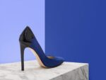 Regin attracts the eye with an elegant spectator back detail. In striking cobalt blue kid suede featuring a black patent back quarter and heel. This striking pump is a wardrobe essential.