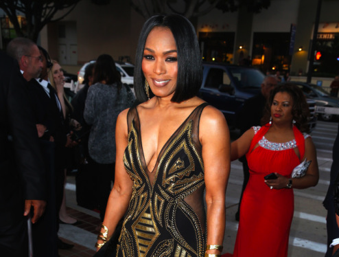 Angela Bassett Stuns in a Black & Gold gown by Xtreme