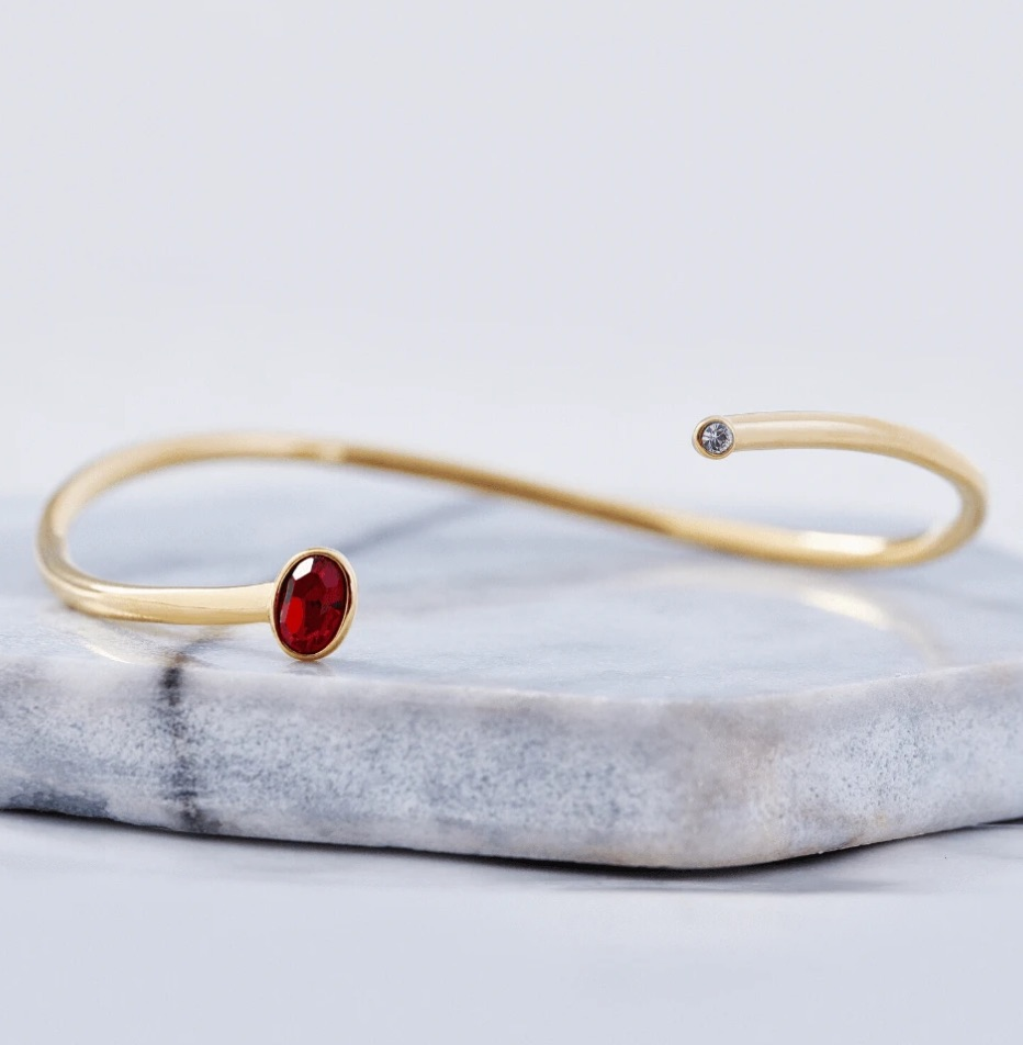 Capsul Jewelry infinity-shaped birthstone cuffs and rings