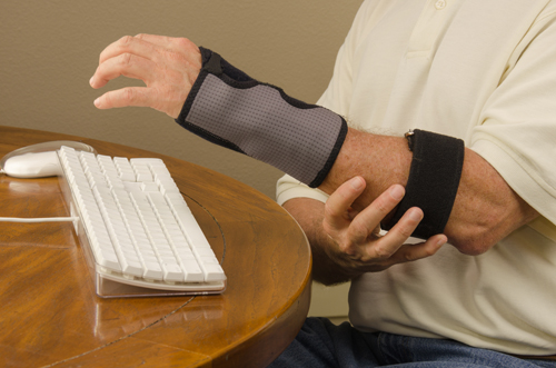 Injured wrist and forearm from carpal tunnel due to typing on a keyboard
