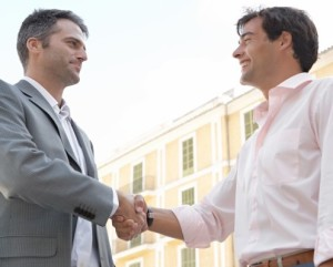 Image of Two men shaking hands