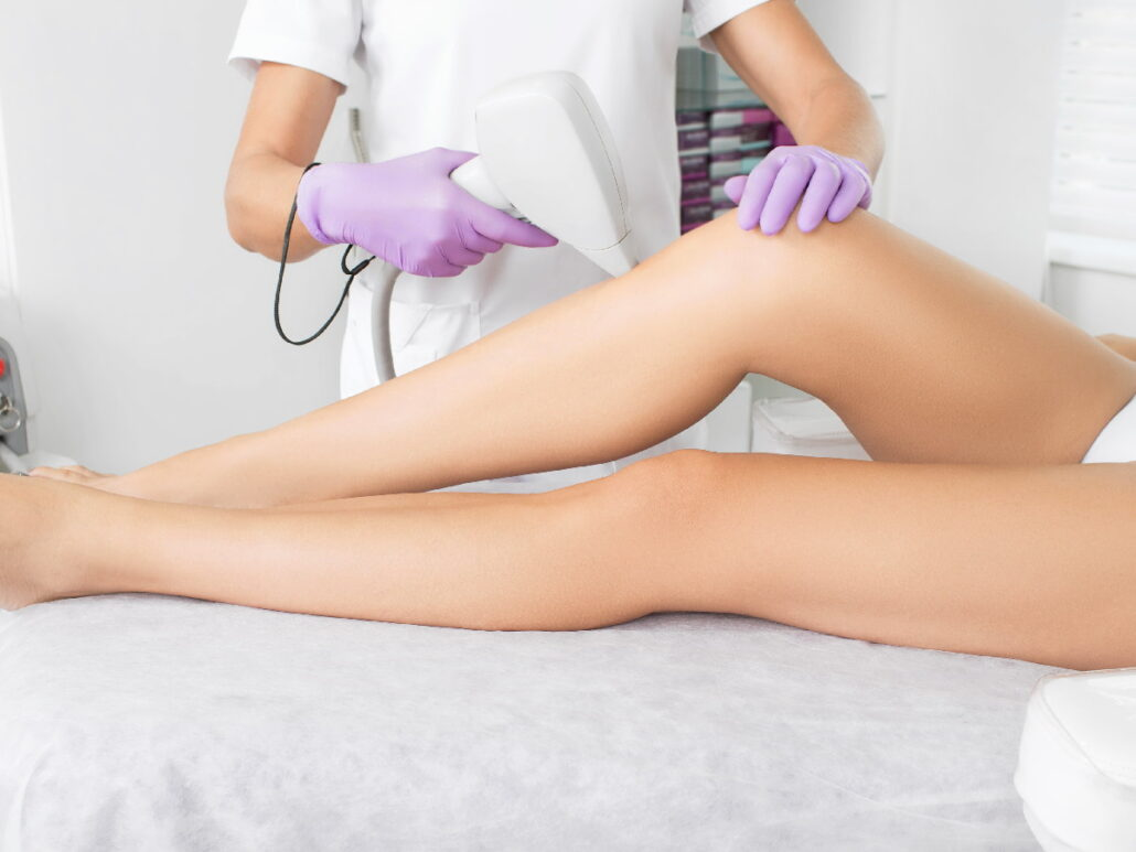 A woman receiving laser hair removal on her legs