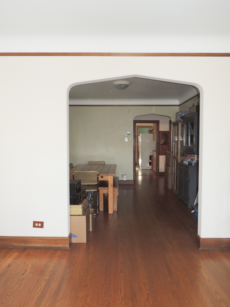 Looking into the dining room and beyond from living room.