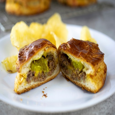 Cheeseburger Turnover with Pickles and chips