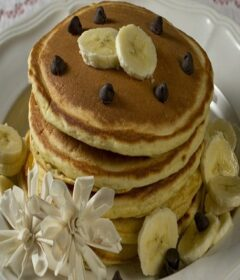 stack of pancakes with bananas